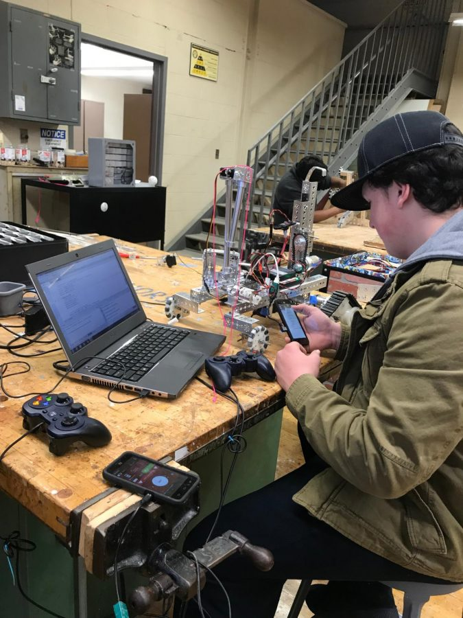 William Kennedy programming this year's robot